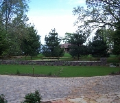 Double Sided Stacked Stone Wall with Landscaping, Arnold