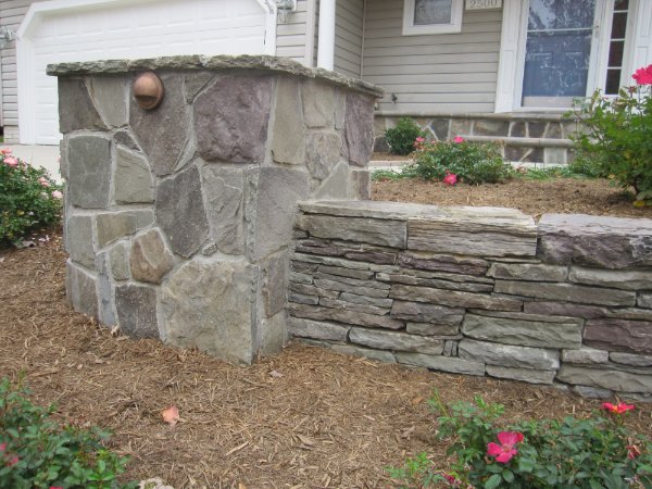 STACKED STONE WALL AND COLUMN WITH LIGHTING