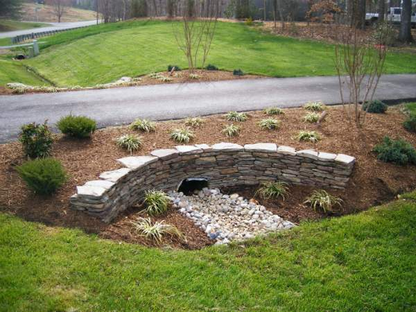 Simple stone border around mailbox colorful annual flowers for Drain pipe landscaping